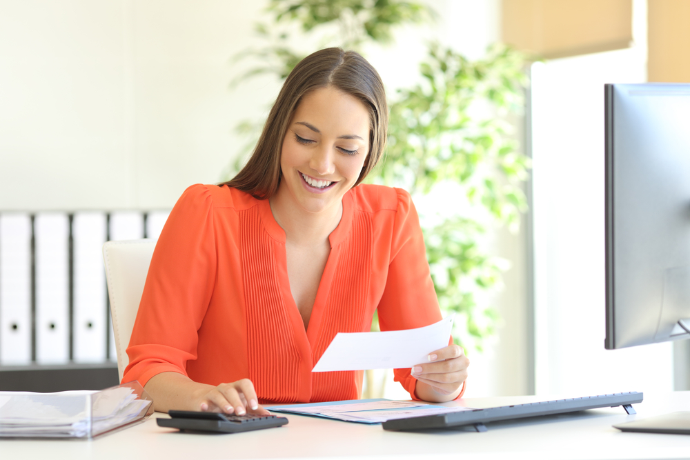 Businesswoman,Wearing,Orange,Blouse,Doing,Accounting,And,Calculating,With,A